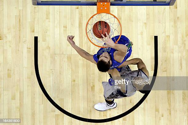 Chase Fieler of the Florida Gulf Coast Eagles dunks in the second half against Mikael Hopkins of the Georgetown Hoyas during the second round of the...