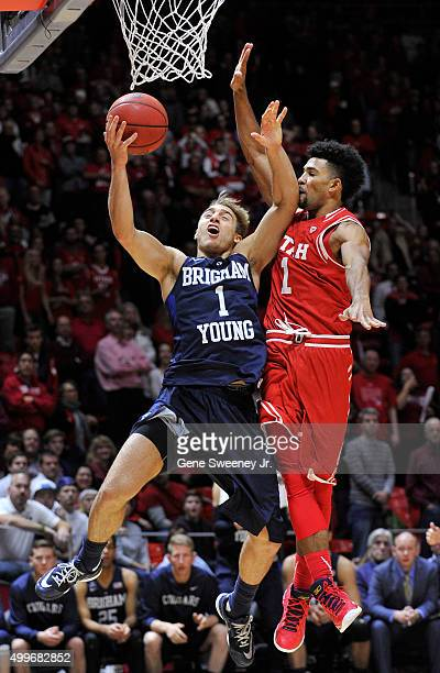 Chase Fischer of the Brigham Young Cougars is fouled at the basket by Isaiah Wright of the Utah Utes in the second half of the Utes 8375 win at the...