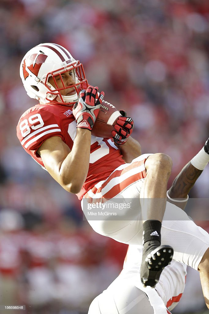 Chase Hammond #89 of the Wisconsin Badgers loses control of this pass while falling to the ground during the first half against the Ohio State Buckeyes at Camp Randall Stadium on November 17, 2012 in Madison, Wisconsin.