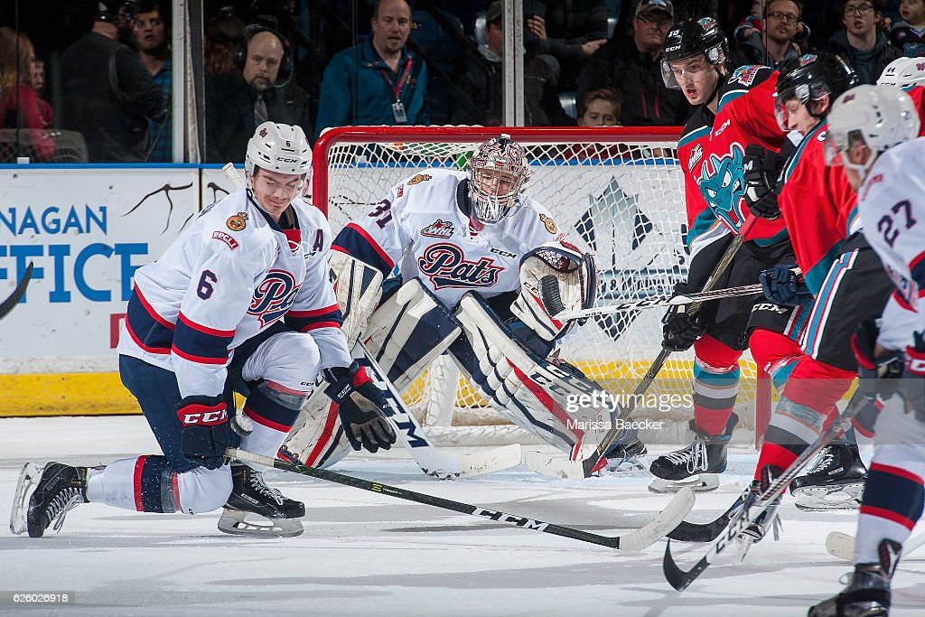 Chase Harrison #6 tries to block a shot on Tyler Brown #31 of the Regina Pats during first period against the Kelowna Rockets on November 26, 2016 at Prospera Place in Kelowna, British Columbia, Canada.