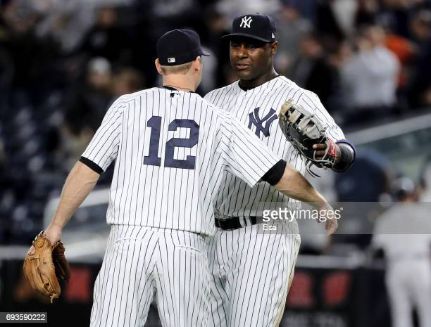 Chase Headley and Chris Carter of the New York Yankees celebrate the 80 win over the Boston Red Sox on June 7 2017 at Yankee Stadium in the Bronx...
