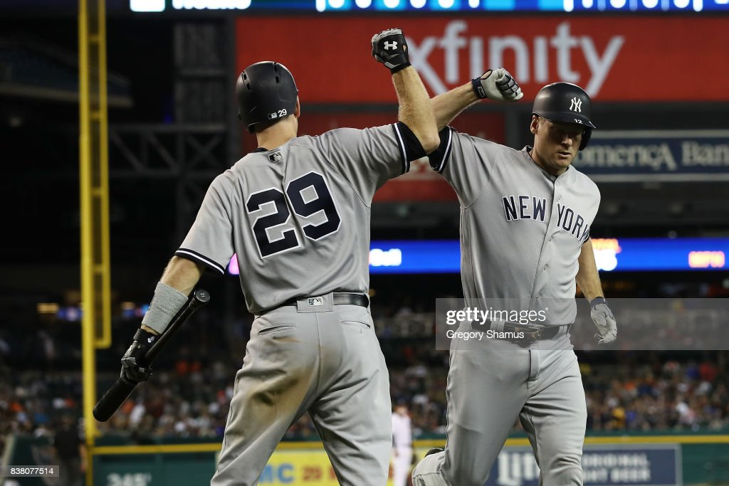 Chase Headley #12 of the New York Yankees celebrates a seventh inning home run with Todd Frazier #29 while playing the Detroit Tigers at Comerica Park on August 23, 2017 in Detroit, Michigan.