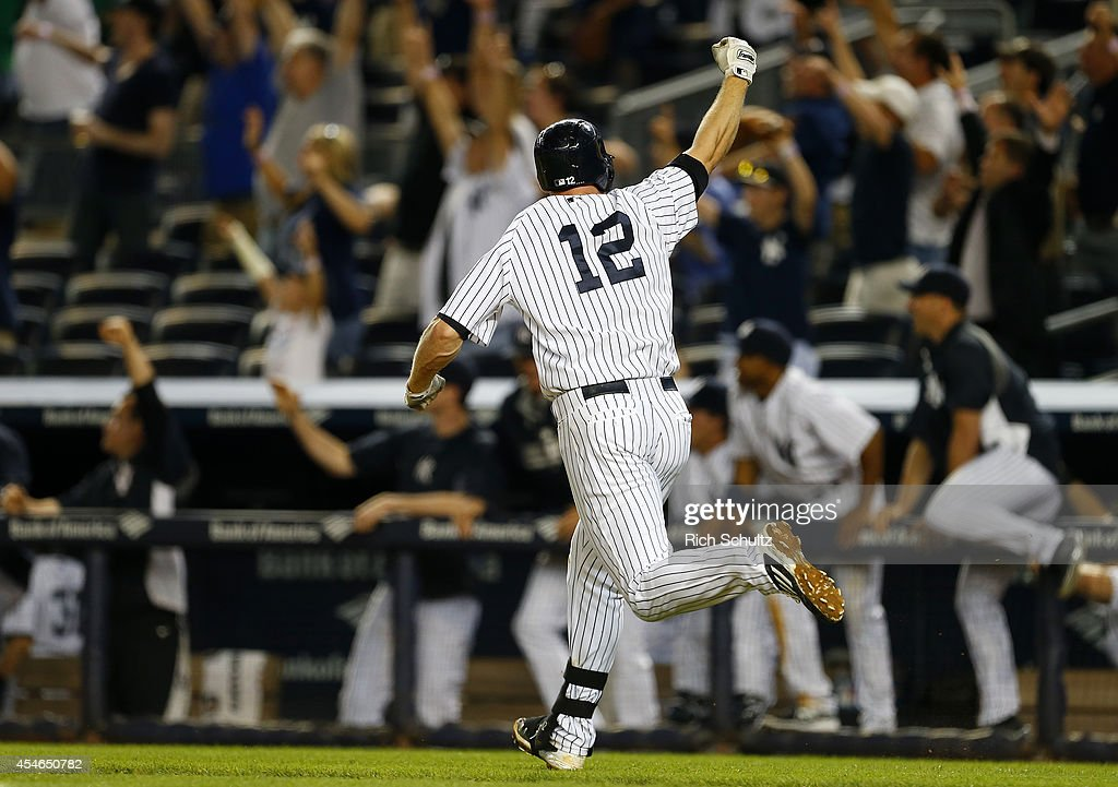 Chase Headley #12 of the New York Yankees celebrates after hitting a walk off home run in the ninth inning to defeat of the Boston Red Sox 5-4 during a MLB baseball game at Yankee Stadium on September 4, 2014 in the Bronx borough of New York City.
