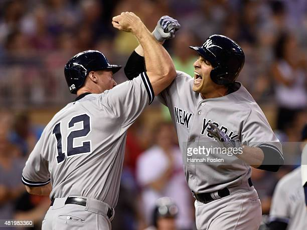 Chase Headley of the New York Yankees congratulates teammate John Ryan Murphy on a threerun home run against the Minnesota Twins during the ninth...