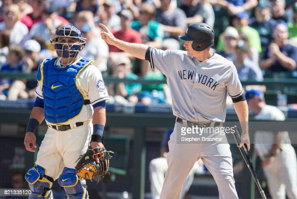 Chase Headley of the New York Yankees gestures to Brett Gardner of the New York Yankees on first base after Headley scored on a single by Gardner off...