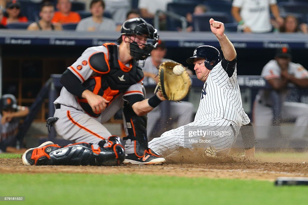 Chase Headley #12 of the New York Yankees scores on Brandon Crawford #35 of the San Francisco Giants throwing error in the eighth inning at Yankee Stadium on July 22, 2016 in the Bronx borough of New York City.
