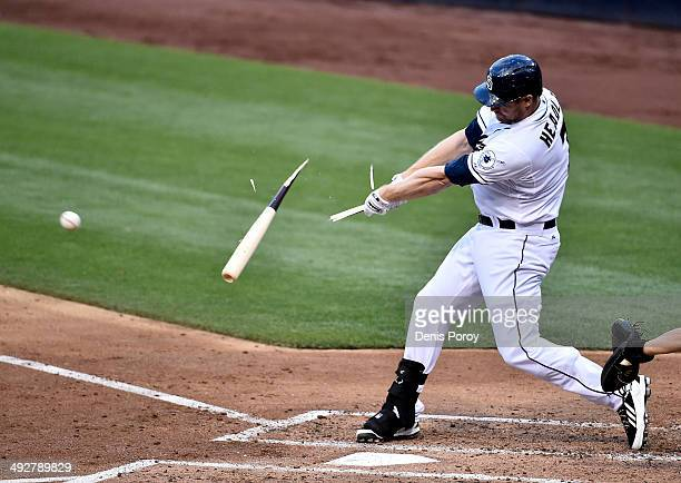 Chase Headley of the San Diego Padres breaks his bat on a single during the third inning of a baseball game against the Minnesota Twins at Petco Park...