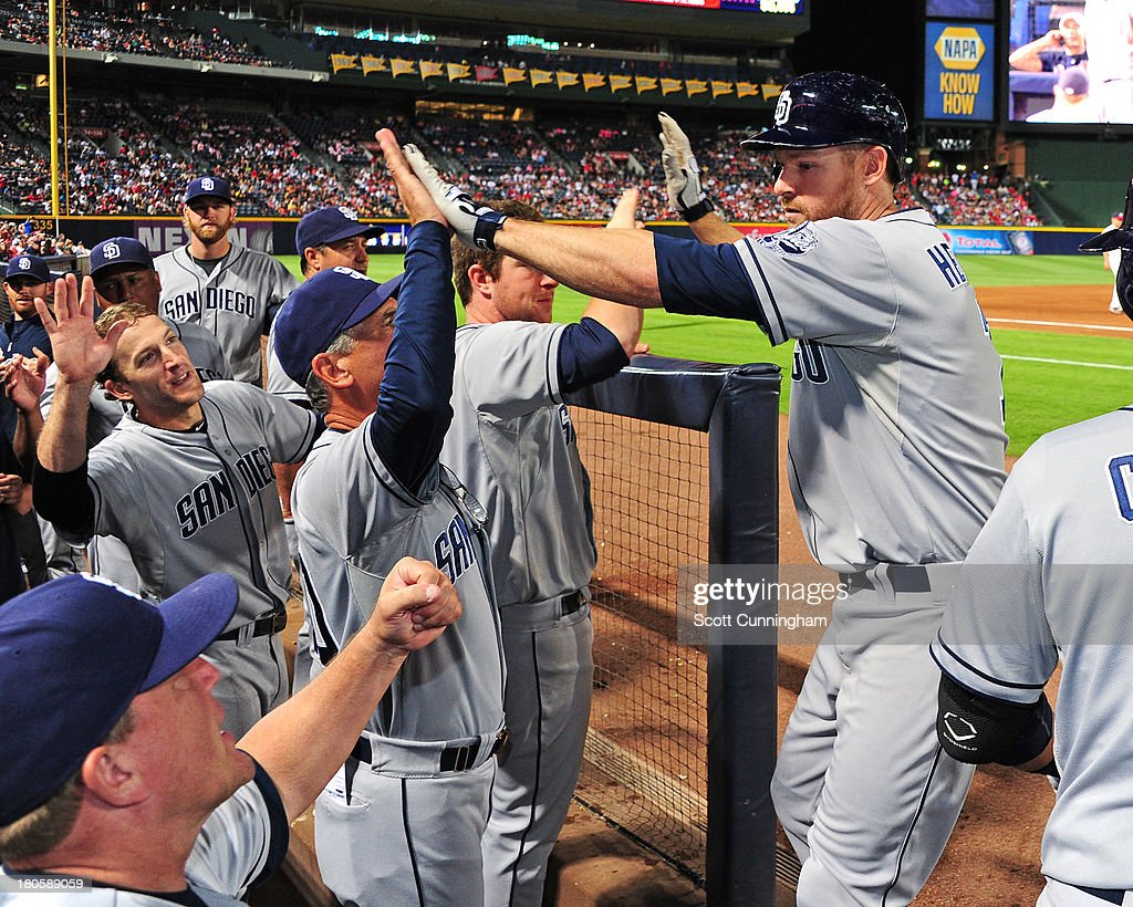 Chase Headley #7 of the San Diego Padres is congratulated by teammates after hitting a ninth inning home run against the Atlanta Braves at Turner Field on September 14, 2013 in Atlanta, Georgia.