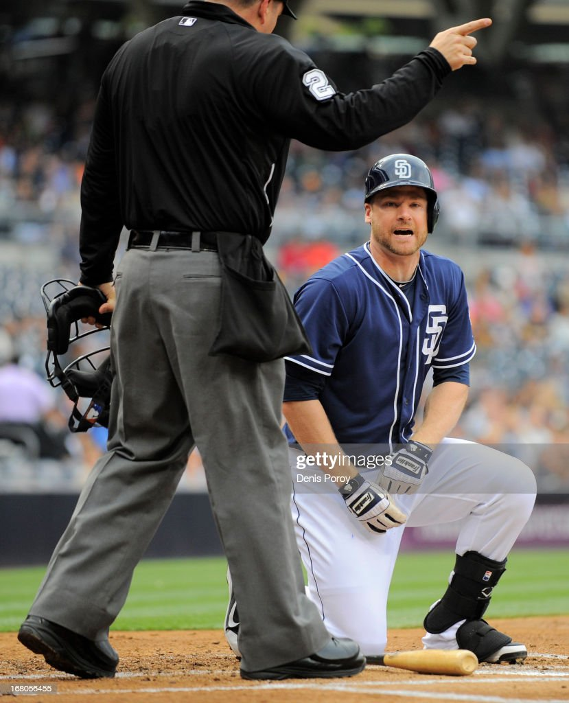 Chase Headley #7 of the San Diego Padres is told to take his base after being hit by a pitch during the first inning of a baseball game against the Arizona Diamondbacks at Petco Park on May 4, 2013 in San Diego, California.