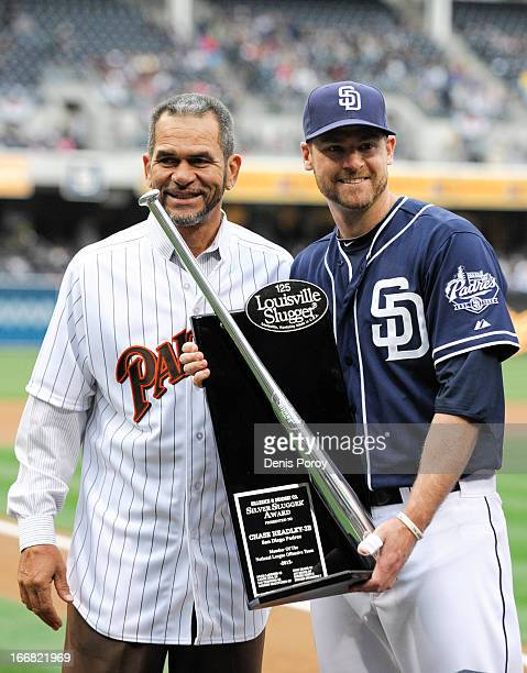 Chase Headley of the San Diego Padres poses with former Padres Benito Santiago after winning the Silver Slugger award before a baseball game between...