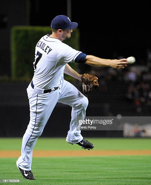 Chase Headley of the San Diego Padres throw to first base on a hit by Martin Prado of the Arizona Diamondbacks during the second inning of a baseball...