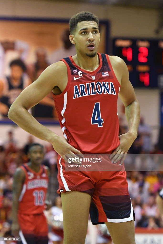 Chase Jeter of the Arizona Wildcats looks on during a first round ...
