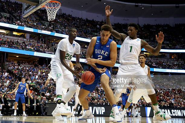 Chase Jeter of the Duke Blue Devils with the ball against Chris Boucher and Jordan Bell of the Oregon Ducks in the 2016 NCAA Men's Basketball...