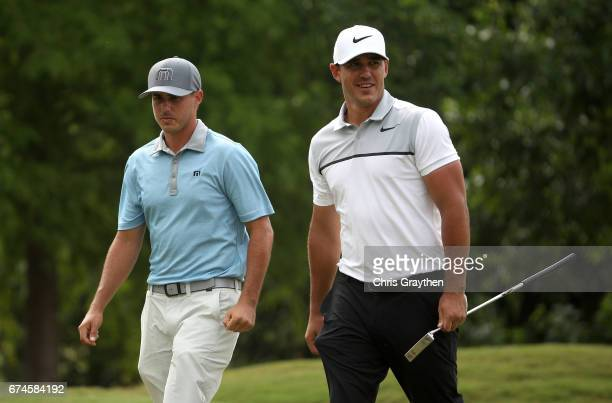 Chase Koepka and Brooks Koepka walk up the fairway during the second round of the Zurich Classic at TPC Louisiana on April 28 2017 in Avondale...