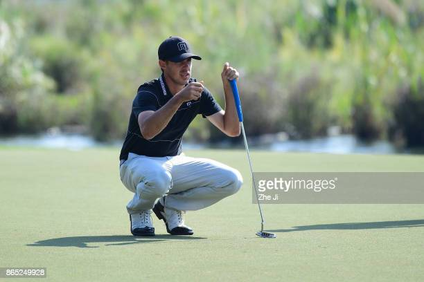 Chase Koepka of the United States lines up a putt during the final round of the 2017 Foshan Open at the Foshan Golf Club on October 22 2017 in Foshan...