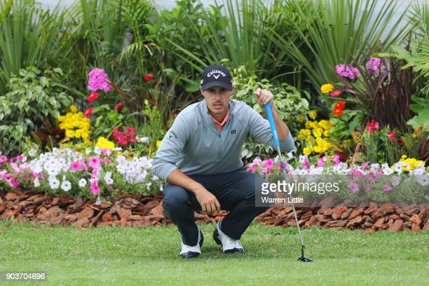 Chase Koepka of the United States lines up a putt on the 18th green during Day One of The BMW South African Open Championship at Glendower Golf Club...