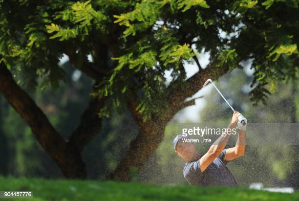 Chase Koepka of the United States plays his second shot on the 15th hole during day three of the BMW South African Open Championship at Glendower...