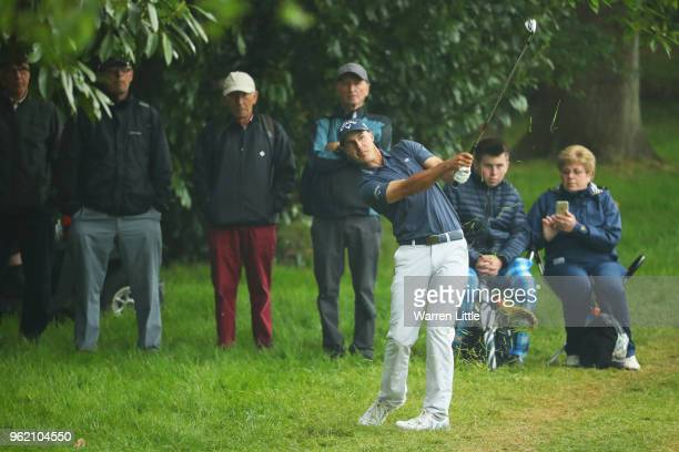 Chase Koepka of the United States plays his second shot on the 4th hole during day one of the BMW PGA Championship at Wentworth on May 24 2018 in...