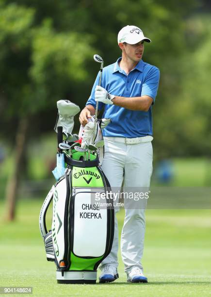 Chase Koepka of the United States takes a club from his bag on the 18th hole during day two of the BMW South African Open Championship at Glendower...