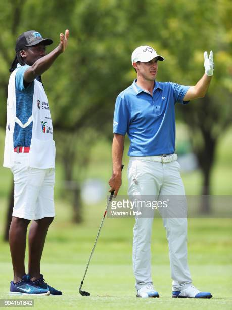 Chase Koepka of the United States talks with his caddie on the 18th hole during day two of the BMW South African Open Championship at Glendower Golf...