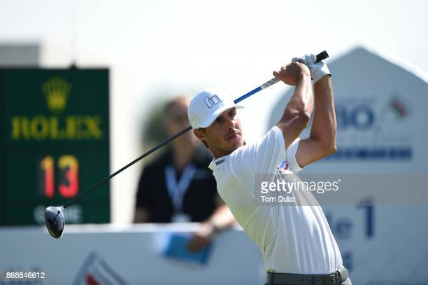 Chase Koepka of the United States tees off on the 1st hole during day one of the NBO Golf Classic Grand Final at Al Mouj Golf on November 1 2017 in...