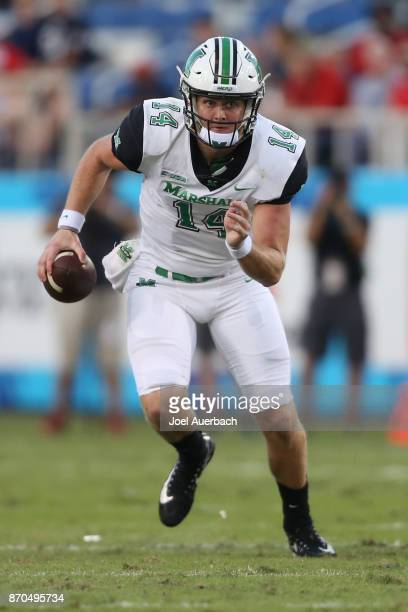 Chase Litton of the Marshall Thundering Herd runs out of the pocket with the ball against the Florida Atlantic Owls at FAU Stadium on November 3 2017...