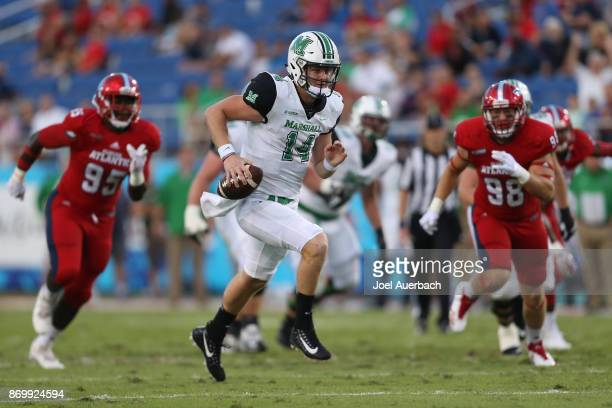 Chase Litton of the Marshall Thundering Herd scrambles out of the pocket during first quarter action against the Florida Atlantic Owls at FAU Stadium...