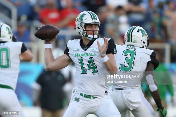 Chase Litton of the Marshall Thundering Herd throws the ball against the Florida Atlantic Owls during first quarter action at FAU Stadium on November...