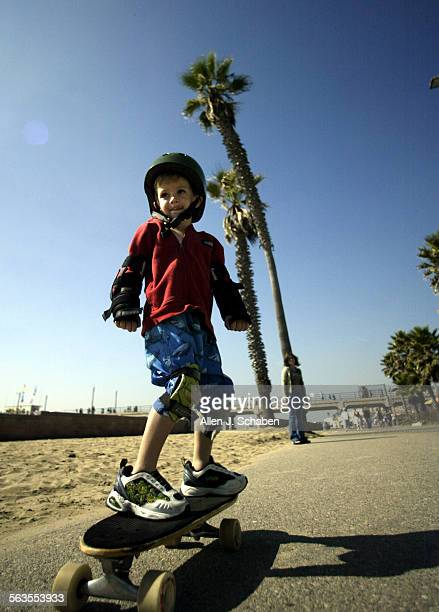 Chase Mann Green of Telluride CO rides his skateboard along the boardwalk at the Huntington Beach pier Saturday October 23 2004