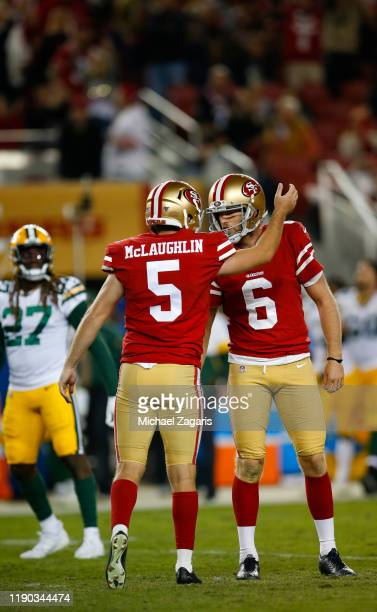 Chase McLaughlin and Mitch Wishnowsky of the San Francisco 49ers celebrate after a PAT during the game against the Green Bay Packers at Levi's...
