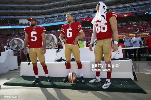 Chase McLaughlin Mitch Wishnowsky and Kyle Nelson of the San Francisco 49ers on the sideline prior to the game against the Arizona Cardinals at...
