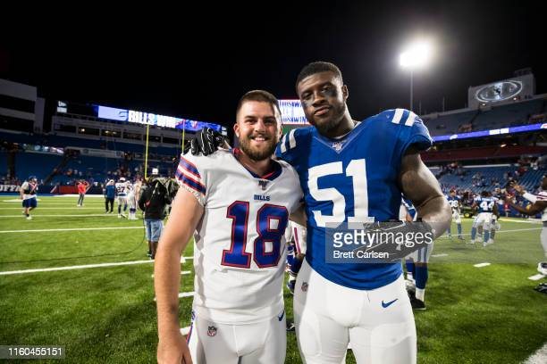 Chase McLaughlin of the Buffalo Bills and Jihad Ward of the Indianapolis Colts pose for a photo after a preseason game at New Era Field on August 8...