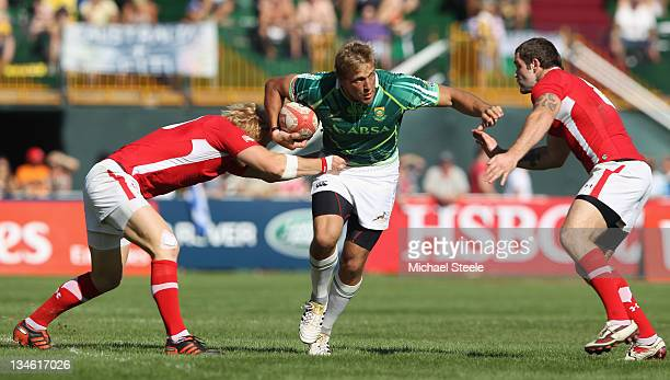 Chase Minnaar of South Africa is caught between Richie Pugh and Rhys Shellard of Wales during the Plate Semi Final match between South Africa and...
