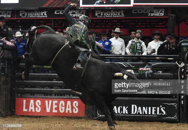 Chase Outlaw rides the bull Big Black during the final round of the Professional Bullriders Mason Lowe Memorial on February 16 at Enterprise Center...