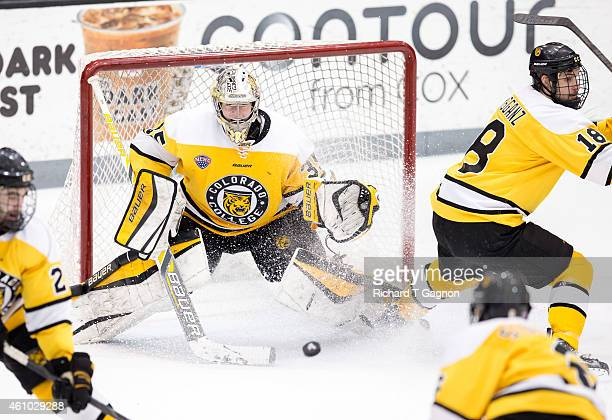 Chase Perry of the Colorado College Tigers watches the puck during NCAA hockey against the Providence College Friars at Schneider Arena on January 4...