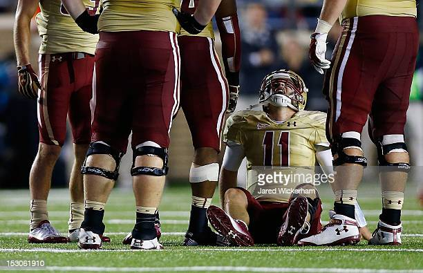 Chase Rettig of the Boston College Eagles grimaces in pain after getting his after throwing a pass against the Clemson Tigers in the second half...