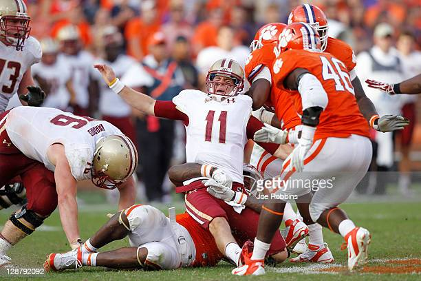 Chase Rettig of the Boston College Eagles grimaces in pain after being hit by Andre Branch of the Clemson Tigers at Memorial Stadium on October 8,...
