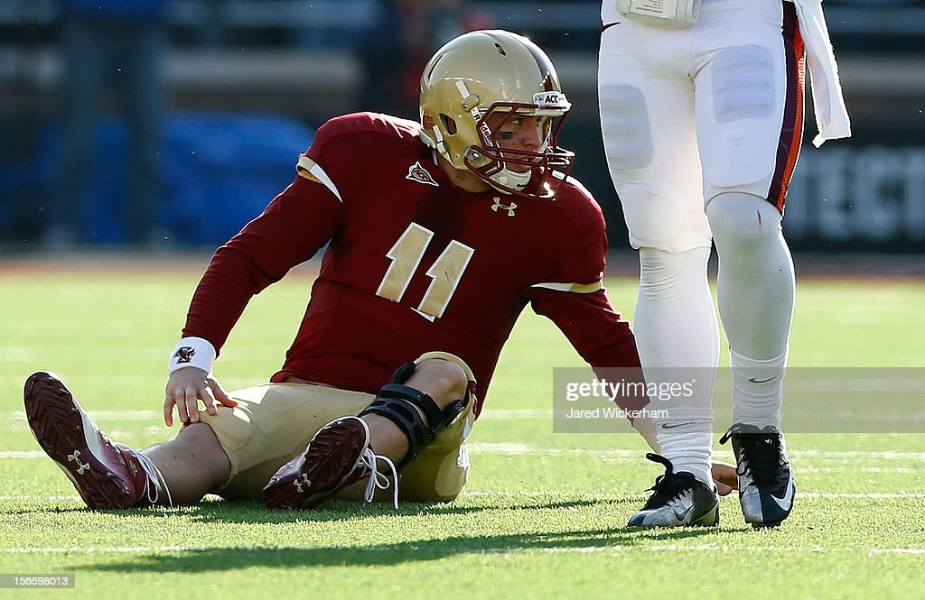 Chase Rettig #11 of the Boston College Eagles sits on the field after being knocked down by the Virginia Tech Hokies defense during the game on November 17, 2012 at Alumni Stadium in Chestnut Hill, Massachusetts.
