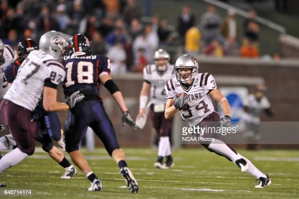 Chase Reynolds of Montana rushes the ball downfield during the 2008 Division I Men's Football Championship held at Finley StadiumDavenport Field in...