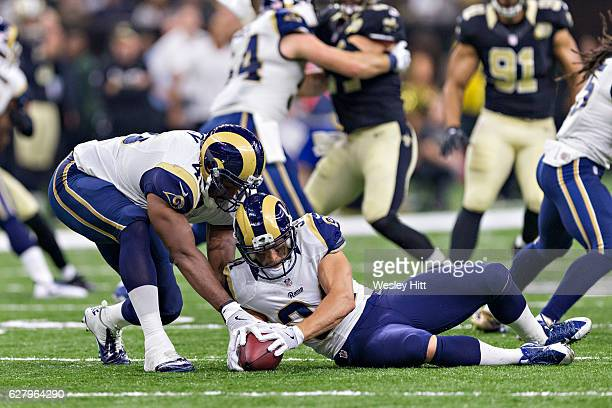 Chase Reynolds of the Los Angeles Rams falls on a loose ball during a game against the New Orleans Saints at MercedesBenz Superdome on November 27...