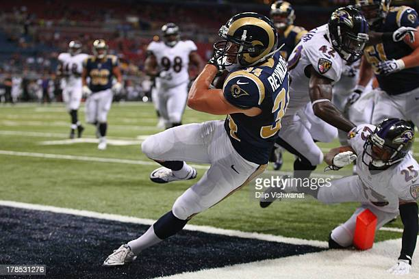 Chase Reynolds of the St Louis Rams scores a touchdown against the Baltimore Ravens during a preseason game at the Edward Jones Dome on August 29...