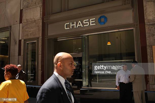 Chase sign is viewed at a bank branch near the company's New York headquarters on May 11 2012 in New York City In a surprise announcement after the...