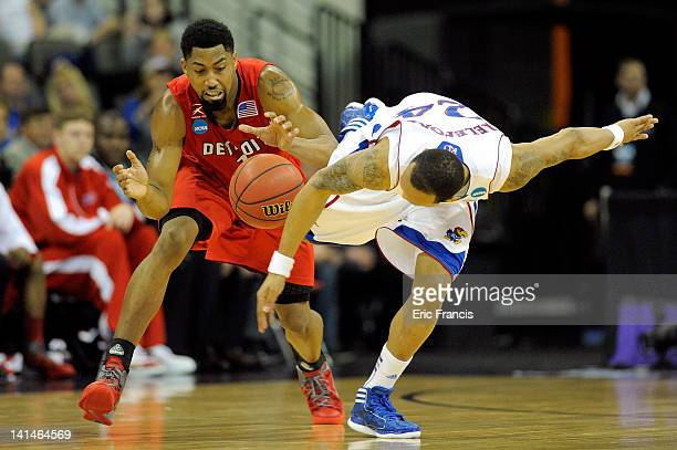 Chase Simon of the Detroit Titans chases down a loose ball against Travis Releford of the Kansas Jayhawks during the second round of the 2012 NCAA...