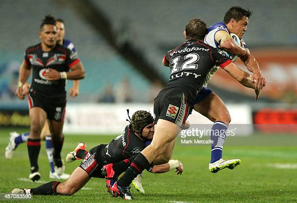 Chase Stanley of the Bulldogs is tackled during the round 26 NRL match between the Canterbury Bulldogs and the New Zealand Warriors at ANZ Stadium on...