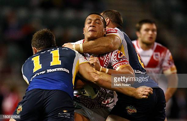 Chase Stanley of the Dragons is tackled high during the round 24 NRL match between the St George Illawarra Dragons and the North Queensland Cowboys...