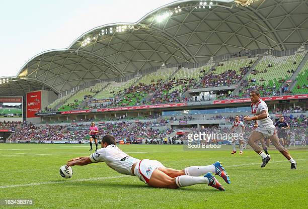 Chase Stanley of the Dragons unsuccessfully attempts to score a try during the round one NRL match between the Melbourne Storm and the St George...