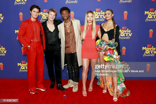 Chase Stokes, Rudy Pankow, Jonathan Daviss, Madelyn Cline, and Madison Bailey attend the 2021 MTV Movie & TV Awards at the Hollywood Palladium on May...