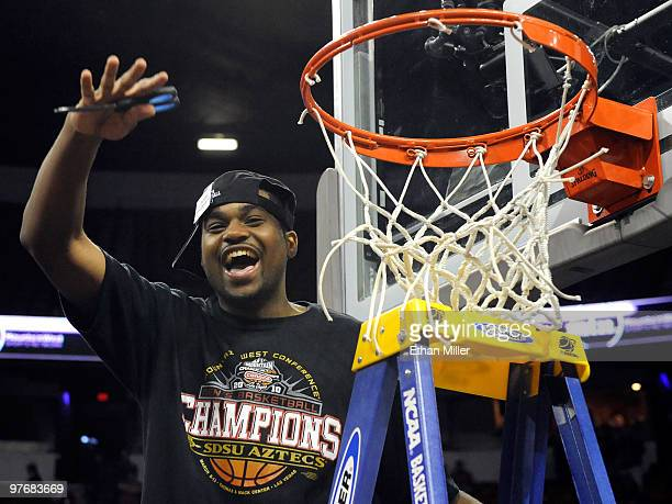 Chase Tapley of the San Diego State Aztecs cuts down the net after defeating the UNLV Rebels 5545 in the championship game of the Conoco Mountain...