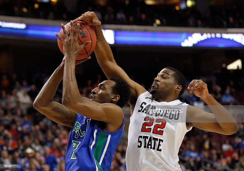 Chase Tapley #22 of the San Diego State Aztecs goes up to block the shot of Bernard Thompson #2 of the Florida Gulf Coast Eagles in the first half during the third round of the 2013 NCAA Men's Basketball Tournament at Wells Fargo Center on March 24, 2013 in Philadelphia, Pennsylvania.