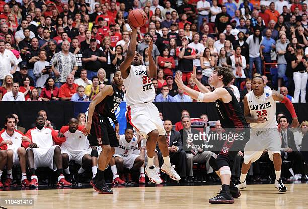 Chase Tapley of the San Diego State Aztecs misses a shot against the Temple Owls in the final seconds of the second half sending the game into...